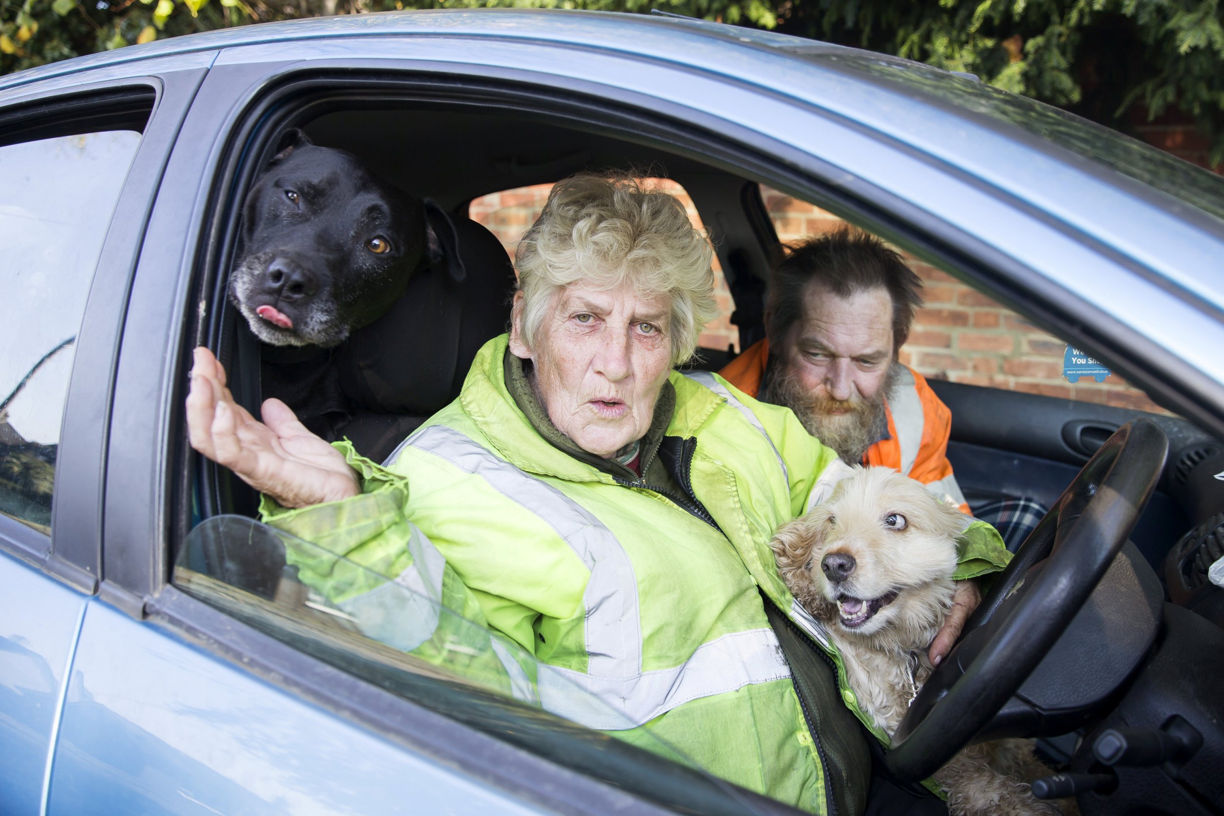Jen and Nigel Tysoe are homeless and due to having dogs are forced to live in a car. See SWNS story SWMDcar. A Northampton couple who lovingly took in their neighbour's two dogs after they died have been living in the front seats of their Peugeot 208 since July. Jennifer, 70, and husband Nigel Tysoe, 54, have refused to give up cocker spaniel Becky and Staffordshire bull terrier Titan after they made a lifelong promise to their friends when they died to care for their pets. The couple, formerly of Lovat Drive, have lived and worked in Northampton all their lives and had planned to spend a peaceful retirement in their home. But in January this year Nigel had a fall, was unable to continue working and the couple's marital home was repossessed. During their time spent sofa surfing for six months, the pair were hit by repeated setbacks.