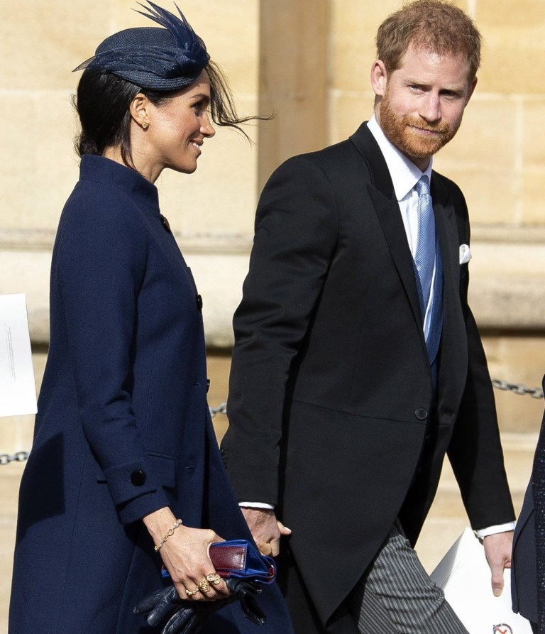epa07088251 Britain's Prince Harry, Duke of Sussex (R) and Meghan, Duchess of Sussex (L) leave after the royal wedding ceremony of Princess Eugenie of York and Jack Brooksbank at St George's Chapel at Windsor Castle, in Windsor, Britain, 12 October 2018. EPA/WILL OLIVER