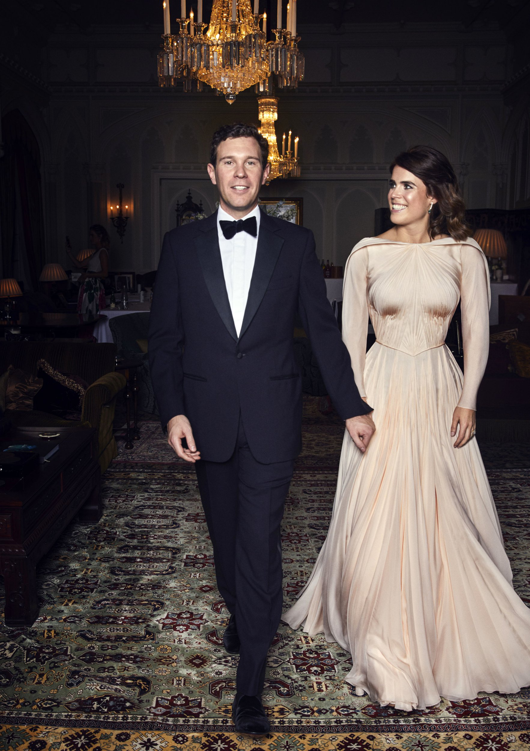 This official wedding photograph released by the Royal Communications of Princess Eugenie and Mr Brooksbank at Royal Lodge, Windsor, ahead of the private evening dinner, following their Wedding. Princess Eugenie's evening dress was designed by Zac Posen. Mr Posen was inspired by the beauty of Windsor and the surrounding countryside. The choice of colour reflects the blush of an English rose. Mr Posen took his inspiration from the White Rose of York. PRESS ASSOCIATION Photo. Issue date: Saturday October 13, 2018. See PA story ROYAL Wedding. Photo credit should read: Alex Bramall/PA Wire Embargoed to 2230 BST Saturday October 13 2018. NEWS EDITORIAL USE ONLY. NO COMMERCIAL USE. NO MERCHANDISING, ADVERTISING, SOUVENIRS, MEMORABILIA or COLOURABLY SIMILAR. NOT FOR USE AFTER 30th April 2019 WITHOUT PRIOR PERMISSION FROM BUCKINGHAM PALACE. NO CROPPING. Copyright in the photograph is vested in Princess Eugenie of York and Mr Jack Brooksbank and Alex Bramall. Publications are asked to credit the photograph to Alex Bramall. No charge should be made for the supply, release or publication of the photograph. The photograph must not be digitally enhanced, manipulated or modified in any manner or form and must include all of the individuals in the photograph when published. NOTE TO EDITORS: This handout photo may only be used in for editorial reporting purposes for the contemporaneous illustration of events, things or the people in the image or facts mentioned in the caption. Reuse of the picture may require further permission from the copyright holder.