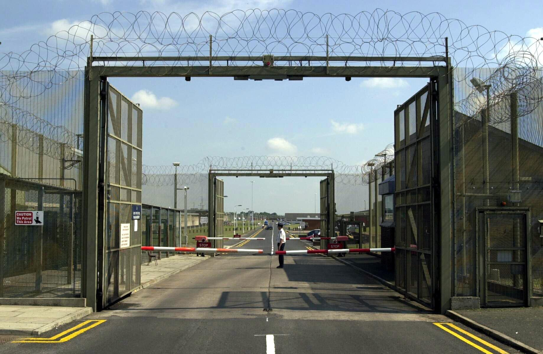The front gates at the entrance of Maghaberry Prison in Northern Ireland, where Loyalist Billy Adair is back behind bars on the orders of Northern Ireland Secretary Peter Mandelson. 27/08/03 Prison staff have searched the top security Northern Ireland jail for a gun amid fears that loyalist inmates have smuggled a weapon inside. All visits to the Bann House section of Maghaberry Prison near Lisburn, Co Antrim, were suspended as warders hunted the cells. Dissident republicans claimed a firearm was pulled during a brutal attack on two men by a gang of loyalists held in the same wing. 21/11/03: Maghaberry jail near Lisburn, Co Antrim, which is being run by police, after warders failed to report for duty. It is believed that the unofficial action, which also affected Magilligan, Co Londonderry, is linked to a major row between management and warders who have demanded increased security to deal with alleged loyalist terrorist threats.