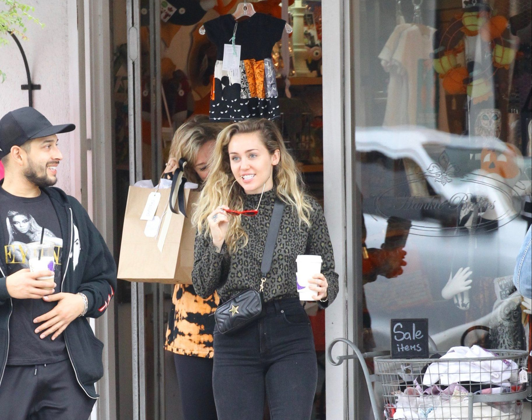 EXCLUSIVE: Miley Cyrus was spotted shopping for organic baby clothes at Hankie Babies in Studio City. Miley was seen shopping for onesies, socks and bibs during the outing. Miley spent twenty minutes inside the shop before leaving. She looked very happy during the shopping trip and her friends were happy for her as she exited the shop. Miley wore red glasses paired with Moschino snow boots. 13 Oct 2018 Pictured: Miley Cyrus shops for organic baby clothes in Studio City. Photo credit: ROMA / MEGA TheMegaAgency.com +1 888 505 6342