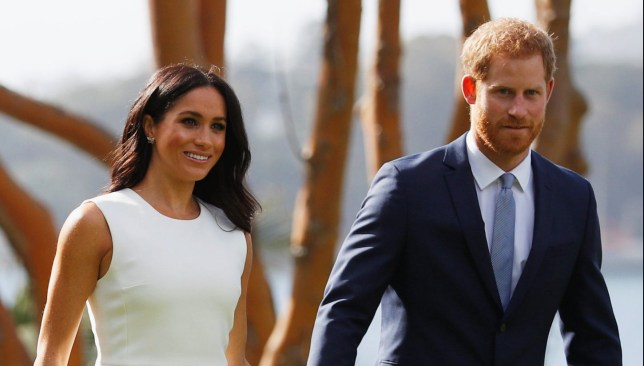 The Duke and Duchess of Sussex walk in the grounds of Admiralty House in Sydney on the first day of the royal couple's visit to Australia. PRESS ASSOCIATION Photo. Picture date: Tuesday October 16, 2018. Harry and Meghan will take part in 76 engagements in Australia, Fiji, Tonga and New Zealand over their 16-day trip to the Pacific region. See PA story ROYAL Tour. Photo credit should read: Phil Noble/PA Wire
