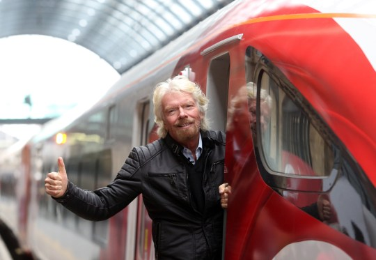 Richard Branson, chairman and founder of Virgin Group Ltd., poses for a photograph on board a new Virgin Azuma high speed train, manufactured by Hitachi Ltd., at Kings Cross station, London, U.K., on Friday, March 18, 2016. Virgin Trains will revive plans to offer high-speed Internet access on Europes busiest rail route in a bid to beat the plane and persuade business people to travel outside peak hours. Photographer: Chris Ratcliffe/Bloomberg via Getty Images