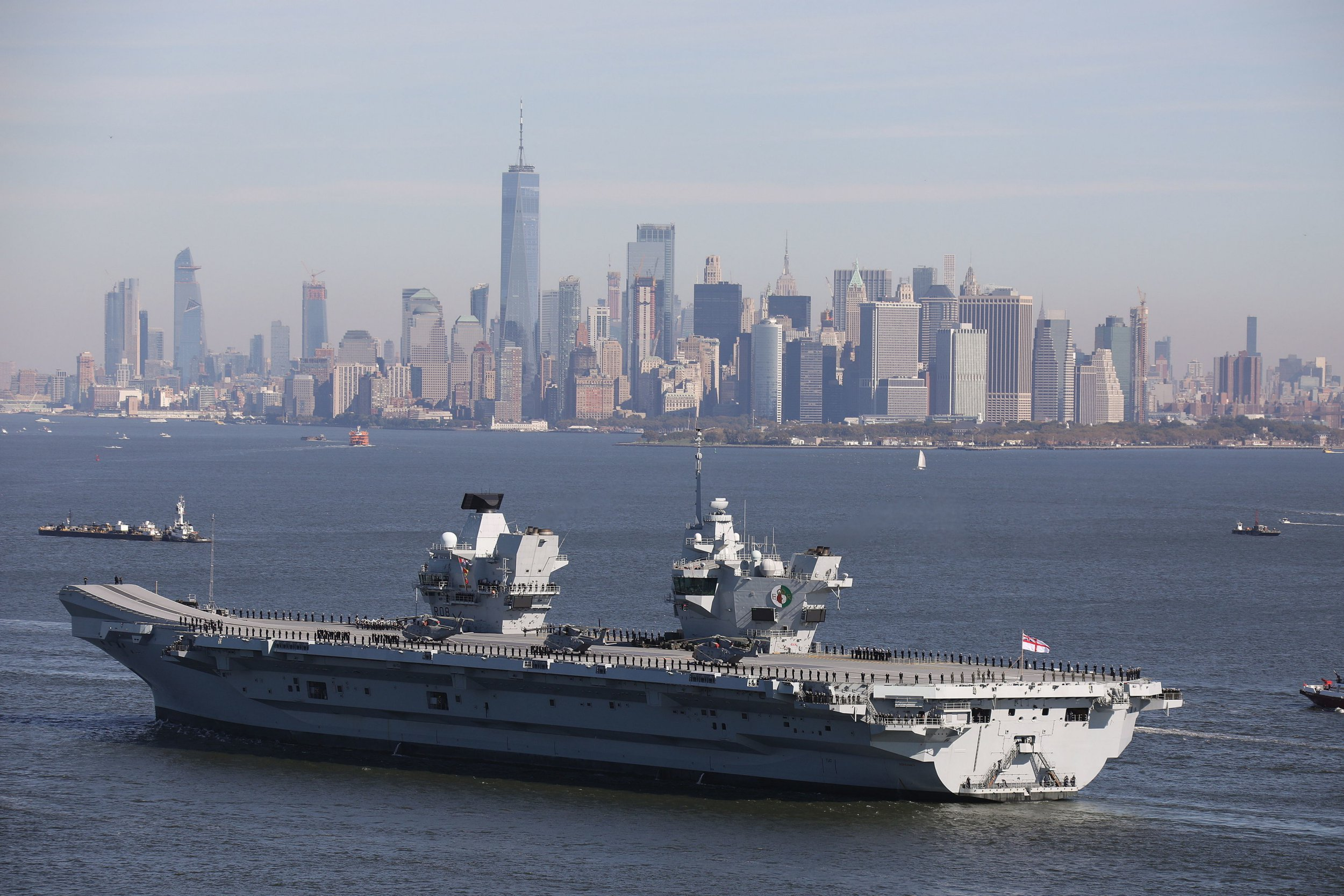 Sailors stand at attention around HMS Queen Elizabeth arriving in New York