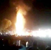 At least 50 people were mowed down by a running train in Amritsar, punjab in India while they went to watch Ravana Dehan on the occasion of Dussehra festival. See SWNS story SWOCtrain; The people were standing on the railway line and watching the Ravana idol burn while the train came and mowed them down. The people couldn't hear the train honks as the loud noise of the crackers concealed the noise of the train horn. In the video, a crowd can be seen gathered watching as the Ravana Idol burns at a distance.