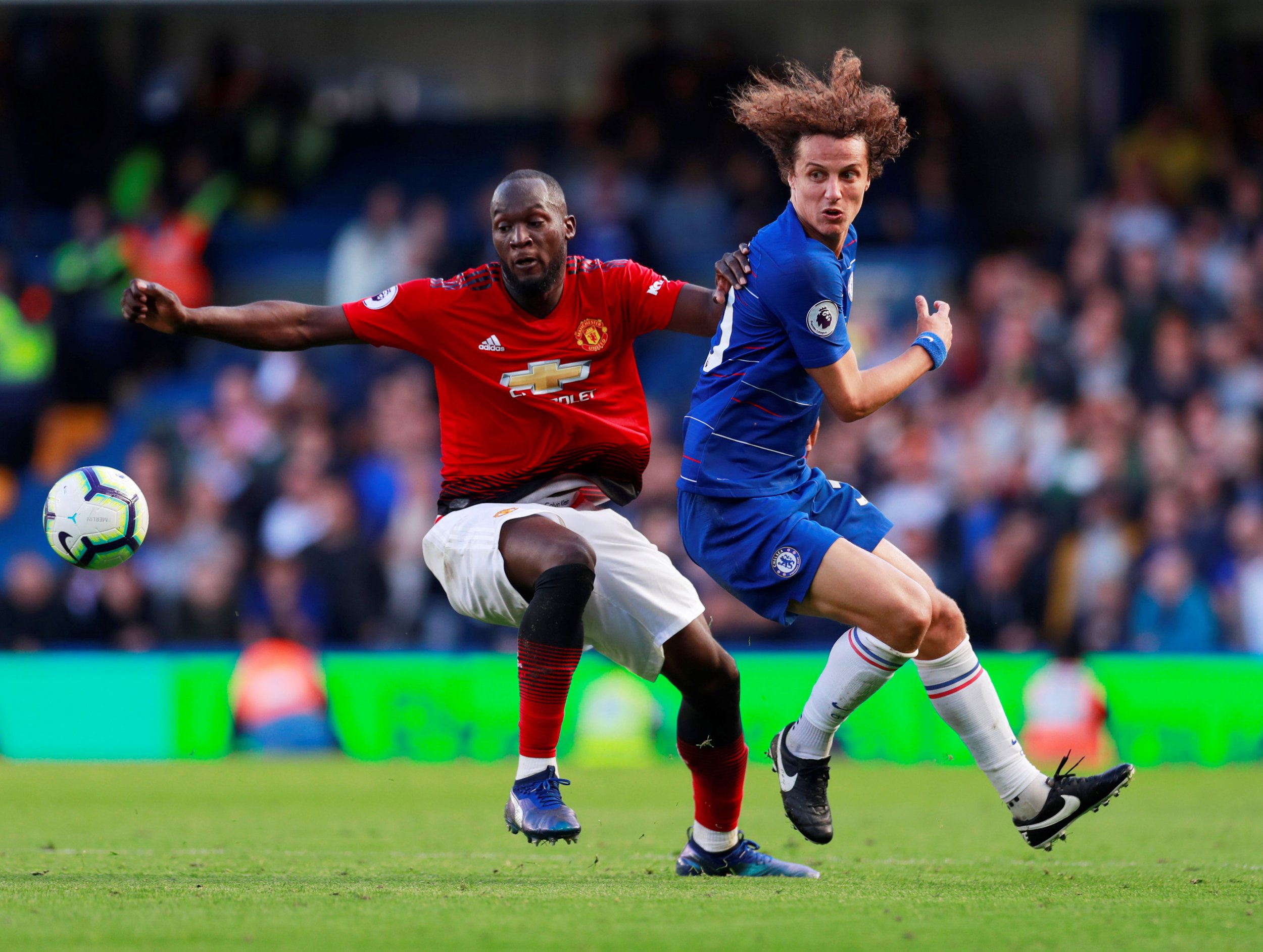 "Soccer Football - Premier League - Chelsea v Manchester United - Stamford Bridge, London, Britain - October 20, 2018 Manchester United's Romelu Lukaku in action with Chelsea's David Luiz Action Images via Reuters/Andrew Couldridge EDITORIAL USE ONLY. No use with unauthorized audio, video, data, fixture lists, club/league logos or ""live"" services. Online in-match use limited to 75 images, no video emulation. No use in betting, games or single club/league/player publications. Please contact your account representative for further details."