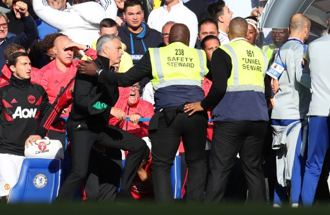LONDON, ENGLAND - OCTOBER 20: Stewards hold back Jose Mourinho, Manager of Manchester United as he clashes with the Chelsea backroom staff during the Premier League match between Chelsea FC and Manchester United at Stamford Bridge on October 20, 2018 in London, United Kingdom. (Photo by Catherine Ivill/Getty Images)