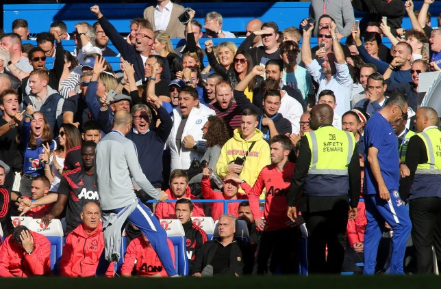 FA Premier League and Football League images are subject to DataCo Licence. Editorial use ONLY. No print sales. No personal use sales. NO UNPAID USE. Mandatory Credit: Photo by TGSPhoto/REX (9938778t) A member of the Chelsea staff celebrates their second goal in front of Manchester United Manager, Jose Mourinho during Chelsea vs Manchester United, Premier League Football at Stamford Bridge on 20th October 2018 Chelsea v Manchester United, Premier League, Football, Stamford Bridge, London, Greater London, United Kingdom - 20 Oct 2018