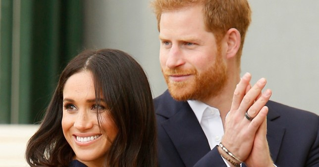 MELBOURNE, AUSTRALIA - OCTOBER 18: Prince Harry, Duke of Sussex and Meghan, Duchess of Sussex applaud the activities at Government House on October 18, 2018 in Melbourne, Australia. The Duke and Duchess of Sussex are on their official 16-day Autumn tour visiting cities in Australia, Fiji, Tonga and New Zealand. (Photo by Darrian Traynor/Getty Images)