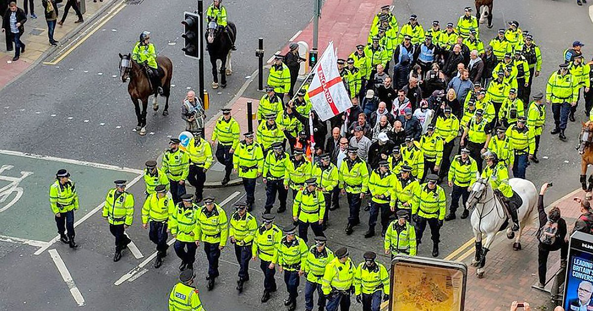 Tiny EDL protest is swamped by police during far-right march in Manchester