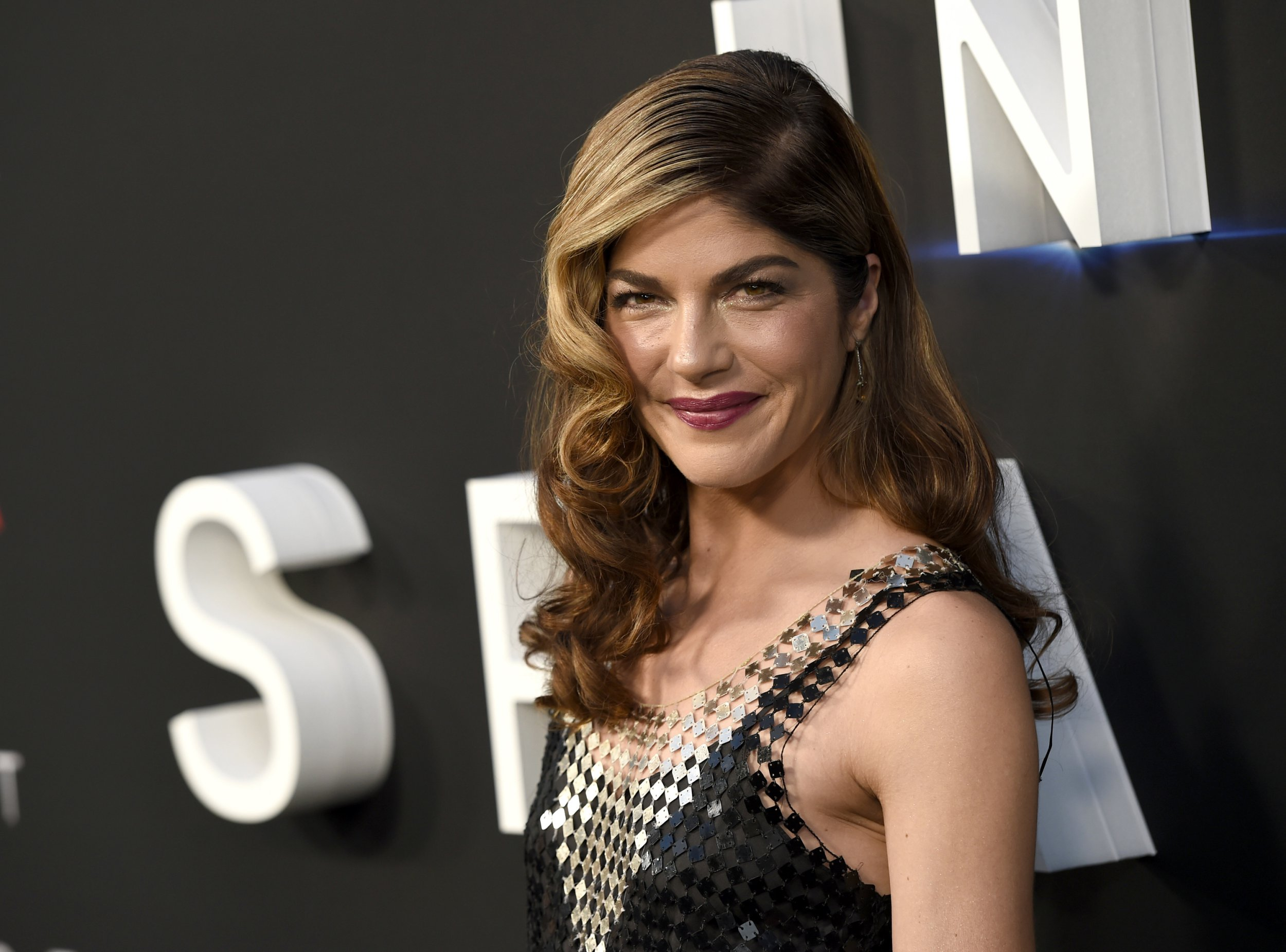 """FILE - In this April 9, 2018 file photo, Selma Blair arrives at the Los Angeles premiere of """"Lost in Space"""" at the ArcLight Cinerama Dome. The film and TV actress has announced she is dealing with a diagnosis of multiple sclerosis. In a post Saturday, Oct. 20, 2018 on her Instagram account, Blair, 46, says she was diagnosed with the disease of the central nervous system on Aug. 16. (Photo by Chris Pizzello/Invision/AP, File)"""