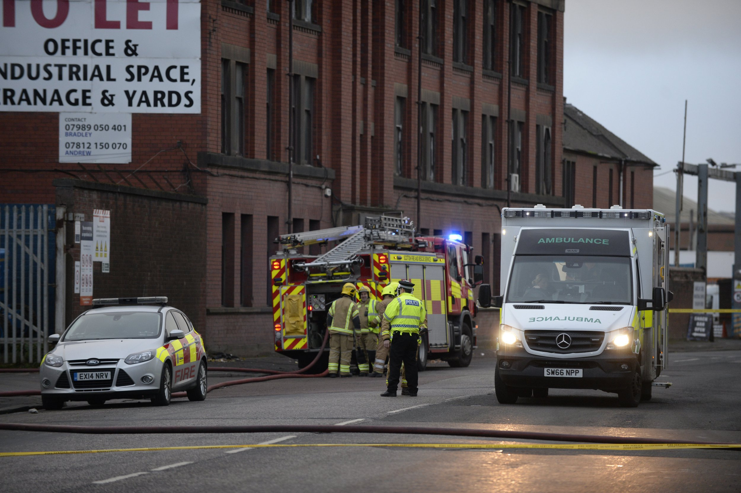 Firefighters attend an incident at a scrapyard on South Street, Glasgow, after an explosion. October 23, 2018. Emergency services have been called to reports of an explosion at a factory in the Whiteinch area of Glasgow. Police, ambulance and fire crews are at the scene around South Street and a cordon has been put in place in the area. The incident happened at the EMR scrapyard. There are no reports of anyone being injured.