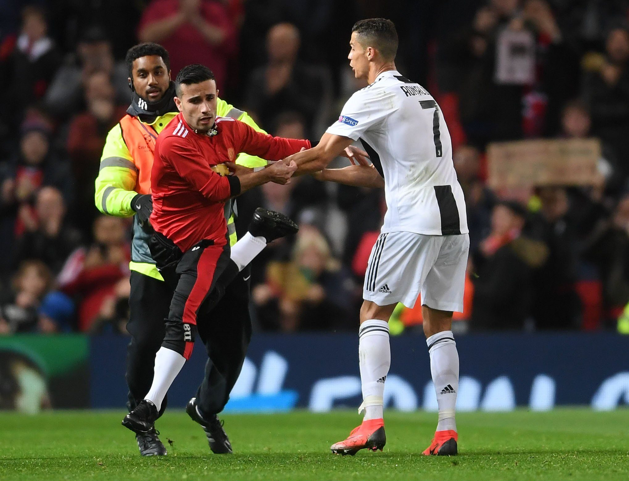 Cristiano Ronaldo takes selfie with pitch invader after Manchester United game