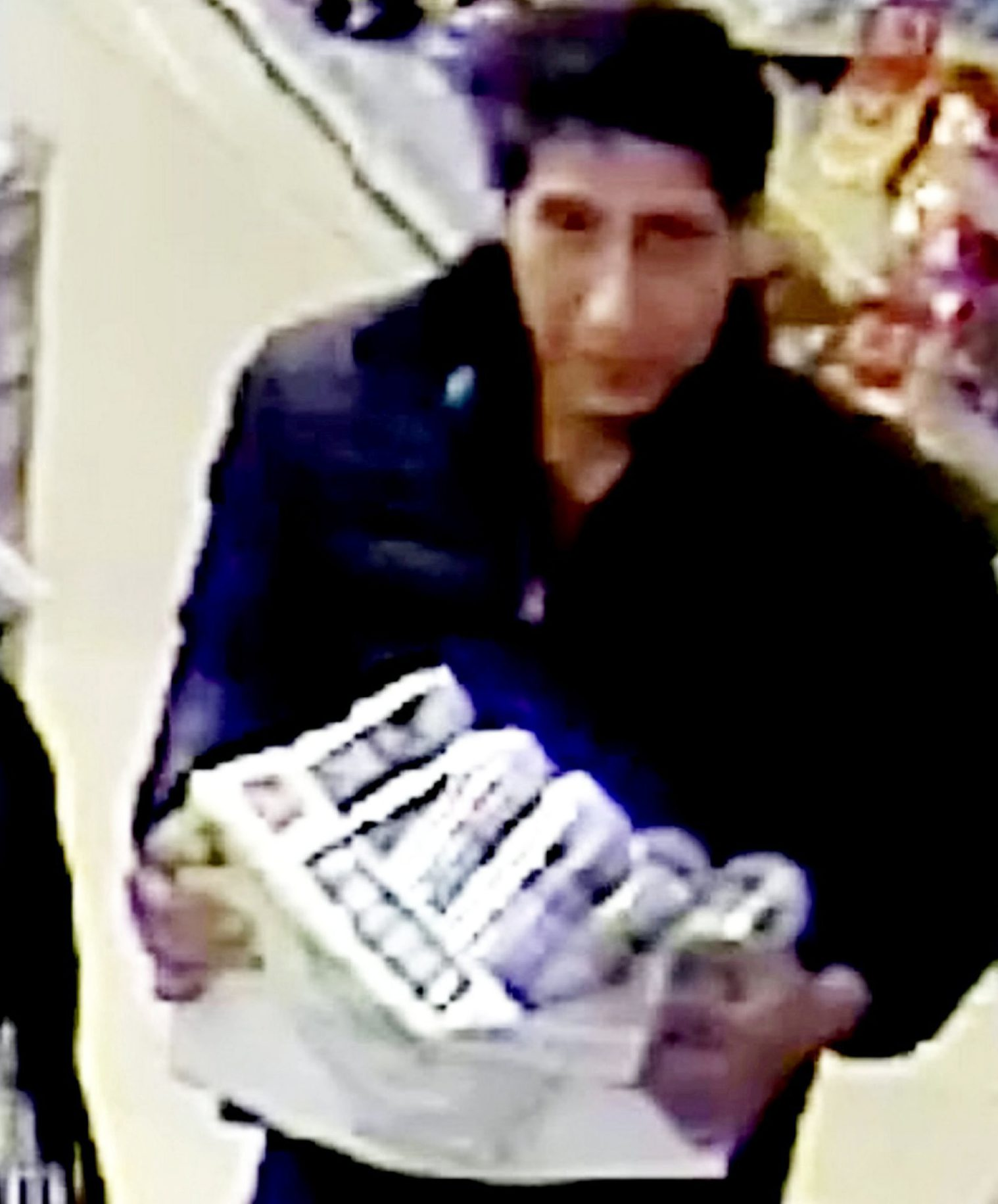 Police have shared a CCTV image of a very unfriendly bloke swiping beer from a restaurant - and he's a spitting image of ?Friends? character Ross Geller. See SWNS story SWLEfriends. Officers shared the CCTV still of the man, who is the double of Friends actor David Schwimmer, clutching a crate of beer. Within minutes, fans of the 90s sitcom had bombarded Blackpool Police's Facebook post with jokes inspired by show. Police later said Schwimmer was not in the UK at the time of the offence.