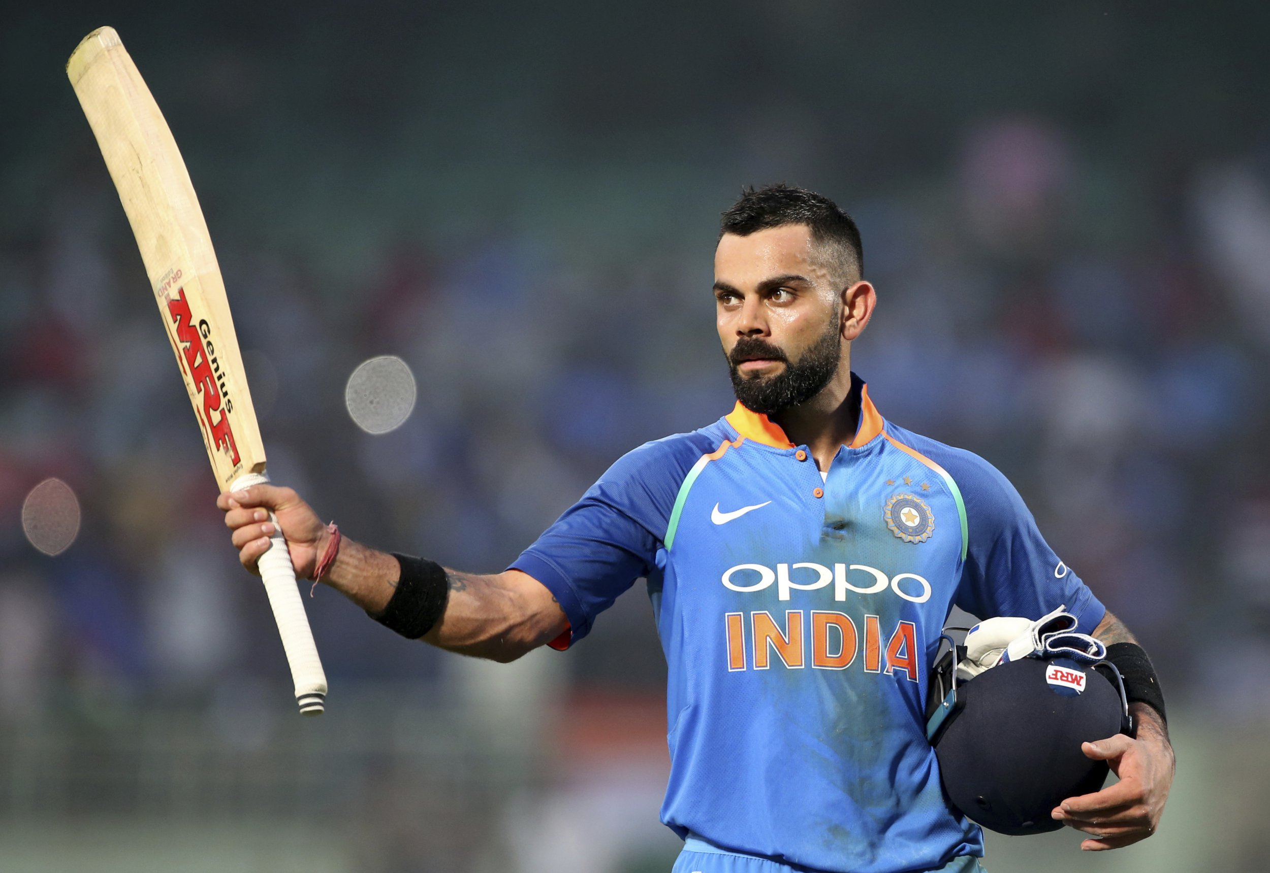 India's captain Virat Kohli raises his bat to acknowledge the applause from the spectators as he leaves the field at the end of their innings during the second one-day international cricket match between India and West Indies in Visakhapatnam, India, Wednesday, Oct. 24, 2018. (AP Photo/Aijaz Rahi)