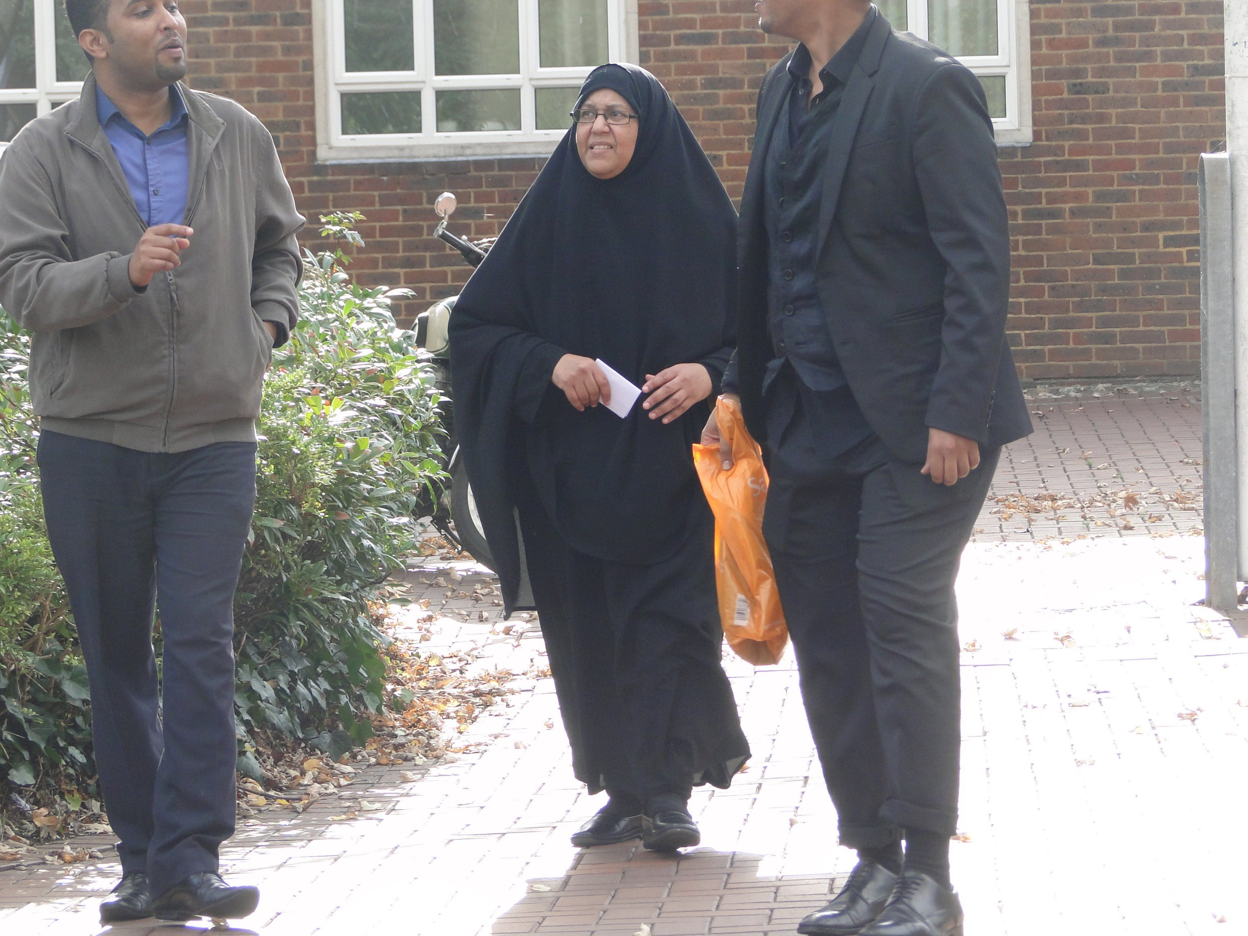 Hana Abdi Qahtan - at court / A refugee who abused her and her family's new British passports to bring in two illegal migrants has been praised for her 'humanitarian desire' by a judge. Somalia-born Hana Abdi Qahtan, 46, tried to pass off a 16-year-old Yemeni as her son at London Heathrow Airport and had another UK passport for an older woman hidden in her hijab.