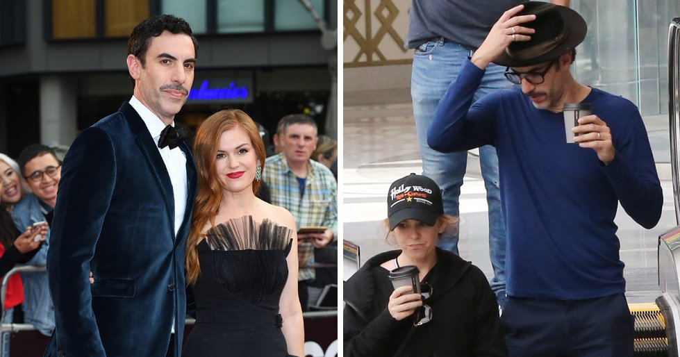 EXCLUSIVE: Sacha Baron Cohen and Isla Fisher keep incognito in hats during a shopping trip in Los Angeles. The pair are spotted on the escalator at the mall drinking out of to-go coffee cups. 24 Oct 2018 Pictured: Sacha Baron Cohen, Isla Fisher. Photo credit: Rachpoot/MEGA TheMegaAgency.com +1 888 505 6342