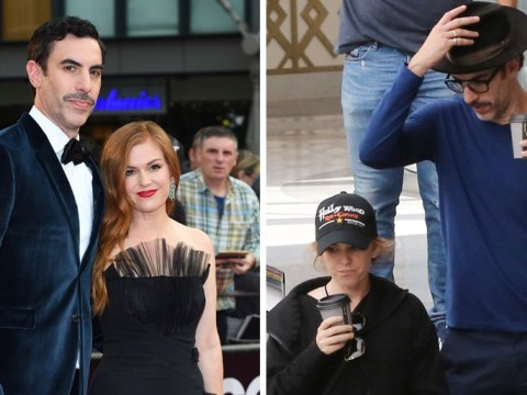 Sacha Baron Cohen and Isla Fisher try (and fail) to shop incognito in rare public outing