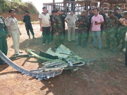 NEWS COPY - WITH PICTURES Residents in a remote Cambodia village are baffled after pieces of a UFO plummeted from the sky yesterday (Thu) morning. Locals in Preah Vihear province said they heard a loud bang at around 6am local time before running outside and discovering dozens of pieces of aluminium. Fragments of the UFO had clattered into homes across a 10km radiums causing damage, but no people were injured. The villagers collected the fragments of the flying object and reported the mystery to police, who have been unable to identity where the wreckage comes from. The discovery - just 300km north of an area where missing flight MH370 was believed to have been seen in the jungle - has sparked fears that the metal could be from an alien aircraft.