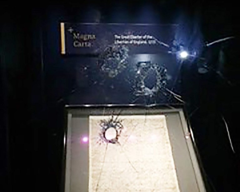 A man has been arrested after he allegedly tried to steal Magna Carta from Salisbury Cathedral.