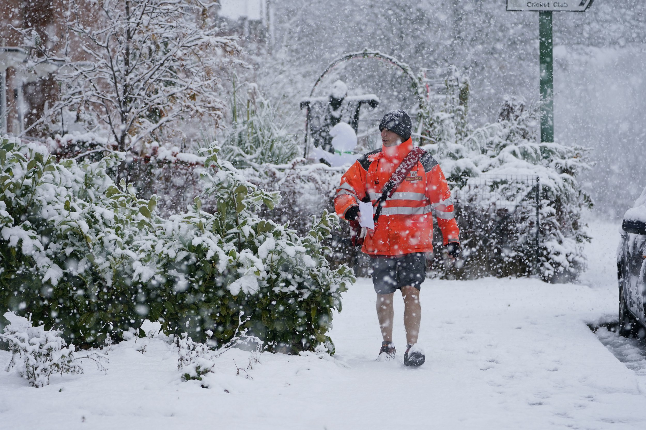 A postman in shorts delivers mail in the snow near Consett, County Durham. PRESS ASSOCIATION Photo. Picture date: Saturday October 27, 2018. Forecasters said that cold air sweeping in from the Arctic is set to bring frosty conditions to the UK, with snow and sleet in northern parts. See PA story WEATHER Snow. Photo credit should read: Owen Humphreys/PA Wire