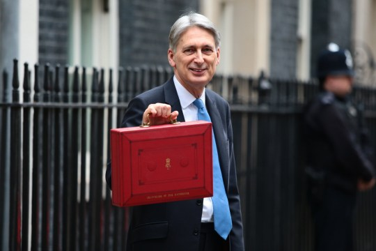 LONDON, ENGLAND - NOVEMBER 22: Britain's Chancellor of the Exchequer Philip Hammond holds the red case as he departs 11 Downing Street to deliver his budget to Parliament on November 22, 2017 in London, England. Later today Chancellor of the Exchequer Philip Hammond will deliver his 2017 budget to Parliament. The conservative government is continuing with its aim of reducing the deficit and balancing the books as the UK negotiates its departure from the European Union. (Photo by Jack Taylor/Getty Images)