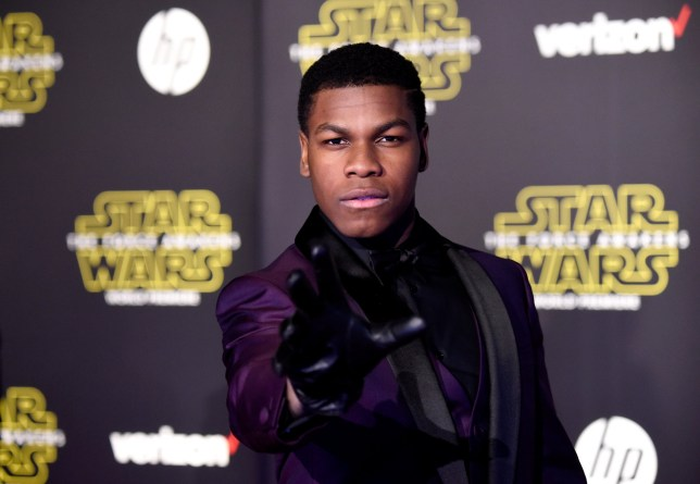 """HOLLYWOOD, CA - DECEMBER 14: Actor John Boyega attends the premiere of Walt Disney Pictures and Lucasfilm's """"Star Wars: The Force Awakens"""" on December 14th, 2015 in Hollywood, California. (Photo by Frazer Harrison/Getty Images)"""