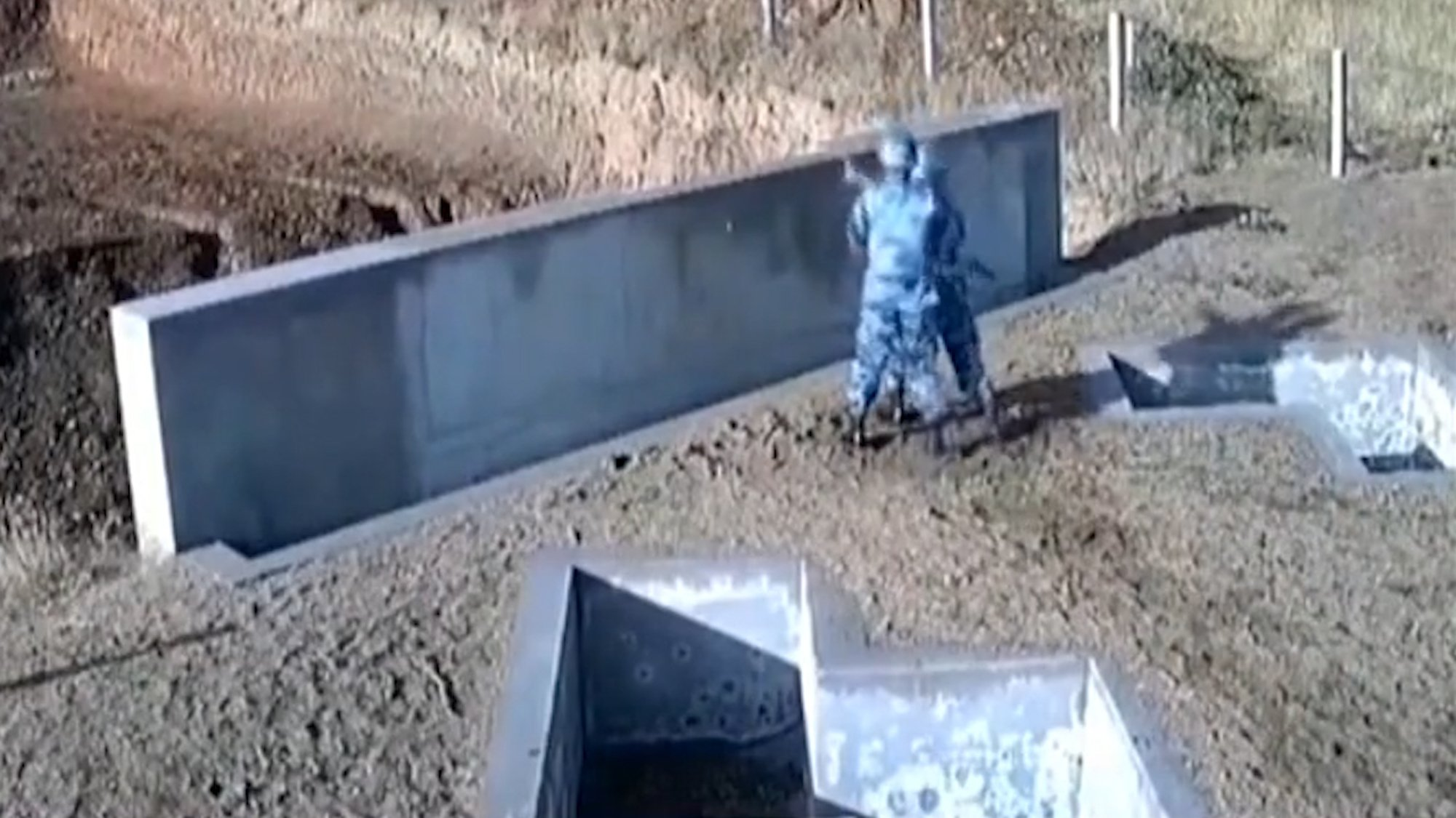 """Pic shows: The nervous cadet throwing the grenade into the wall barrier causing the grenade to land and explode close to him. The Chinese military has released footage showing a nervous air force cadet nearly blowing himself and his instructor up following a failed hand grenade toss. The video carried by state broadcaster China Central Television shows the close call at the People???s Liberation Army Air Force Harbin Flight Academy. The training facility is located in the city of Harbin, capital of north-eastern China???s Heilongjiang Province. The cadet and his new group of trainees were learning basic hand grenade throwing techniques when the blunder happened, reports said. Footage from the academy training ground shows the unnamed newbie soldier reporting to his instructor, Xu Hao, who is standing next to a protective wall where the exercise was to be held. Following a short conversation, the cadet hurls the grenade but gets his angles all wrong, causing the explosive to strike the low wall and bounce back towards them. The hand grenade rolls onto the ground about two metres (six feet) away from them, and the quick-thinking instructor grabs the cadet and leaps into a concrete foxhole nearby. Just three seconds after the bungling solder???s initial throw, the grenade explodes. Xu said: """"The incorrect angle of his wrist during the throw caused the hand grenade to hit the wall to rebound to our left. """"I recognised an emergency situation, so I grabbed him and we jumped into the foxhole as discussed beforehand."""" Had it not been for Xu???s actions, the pair might have suffered serious injuries due to the grenade???s effective kill radius of six metres - roughly 20 feet. The academy said the cadet all passed in the end."""