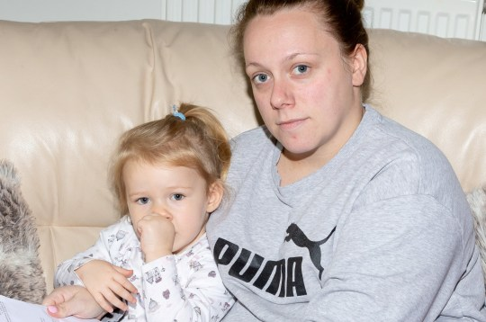 Dionne Burrows, 28, and daughter Ava. Families are living in fear and fleeing their homes at an apartment block infested with false widows. See NATIONAL story NNSPIDERS. Terrified residents said communal areas are crawling with the poisonous spiders that can be seen dangling their legs out from cracks in the walls and hiding under the stairs. The insects - Britain's most venomous spider - are also invading their homes at Quayside House, in Newham, east London, where schools were forced to close due to earlier infestations in early October. Mum-of-two Dionne Burrows, who lives on the first floor, first spotted false widows inside her flat a month ago but despite the landlord's efforts to fumigate her home twice, said the insects still remain. The 28-year-old was forced to stay in a hotel room, with her nine-year-old son Luke and two-year-old daughter Ava, after she was bitten at her flat and suffered a bad reaction. The single mum said Luke is so petrified he is staying with his great nan, 83, until the problem is resolved after he found a false widow next to his bed and dead spiders sprawled across his windowsill.