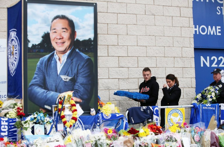 LEICESTER, ENGLAND - OCTOBER 30: Leicester City's Jamie Vardy and wife Rebekah Vardy lay a wreath in memory of those killed in the helicopter crash outside King Power Stadium on October 30, 2018 in Leicester, United Kingdom. The owner of Leicester City Football Club, Vichai Srivaddhanaprabha, was among the five people who died in the helicopter crash on Saturday evening after the club's game against West Ham. (Photo by Plumb Images/Leicester City FC via Getty Images)