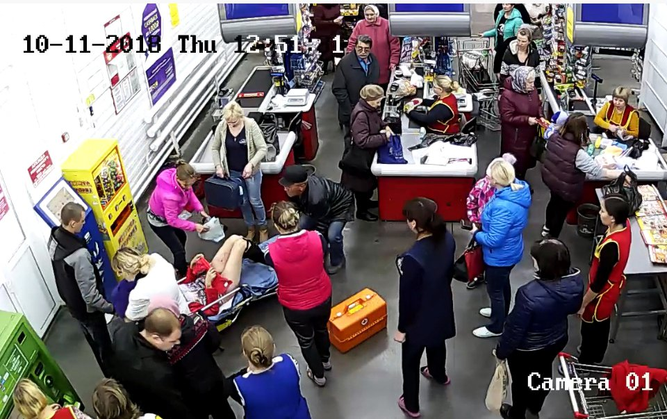 Shoppers ignore woman giving birth on floor and carry on queuing