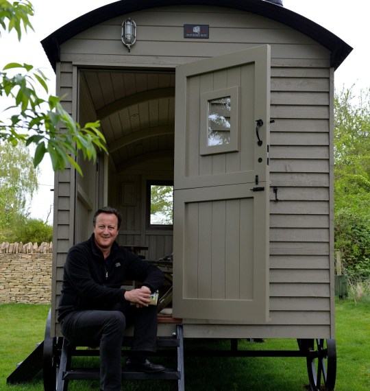 Undated handout photo issued by Red Sky Shepherds Huts of former prime minister David Cameron sitting on the steps of a luxury cabin he has had installed in his Cotswolds garden. PRESS ASSOCIATION Photo. Issue date: Sunday April 30, 2017. Mr Cameron, who suddenly stepped away from the cut and thrust of Westminster politics last year, has seen battle lines drawn with his family for control of a hut from Red Sky Shepherds Huts, whose prices start at ?16,500 but jump with all the added extras. See PA story POLITICS Cameron. Photo credit should read: Graham Flack/Red Sky Shepherds Huts/PA Wire NOTE TO EDITORS: This handout photo may only be used in for editorial reporting purposes for the contemporaneous illustration of events, things or the people in the image or facts mentioned in the caption. Reuse of the picture may require further permission from the copyright holder. MANDATORY CREDIT: Graham Flack/Red Sky Shepherds Huts