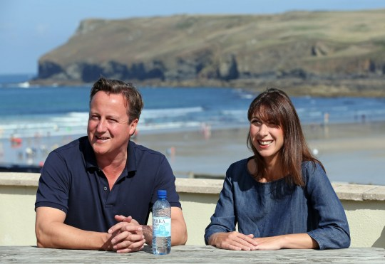 File photo dated 20/08/13 of former Prime Minister David Cameron and his wife Samantha sitting on a bench outside a cafe overlooking the beach at Polzeath during their summer holiday in North Cornwall. PRESS ASSOCIATION Photo. Issue date: Tuesday July 25, 2017. See PA story POLITICS Holidays. Photo credit should read: Matt Cardy/PA Wire