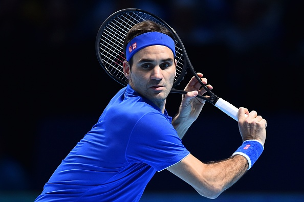 Roger Federer keeps ATP Finals hopes alive with routine Dominic Thiem victory