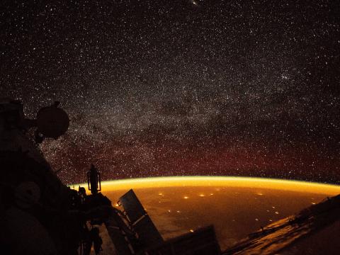 Nasa astronaut photographs weird orange glow surrounding Earth