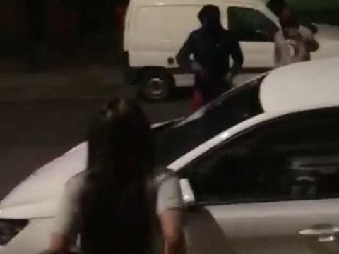 Masked men lunge at woman with baseball bats and smash up car