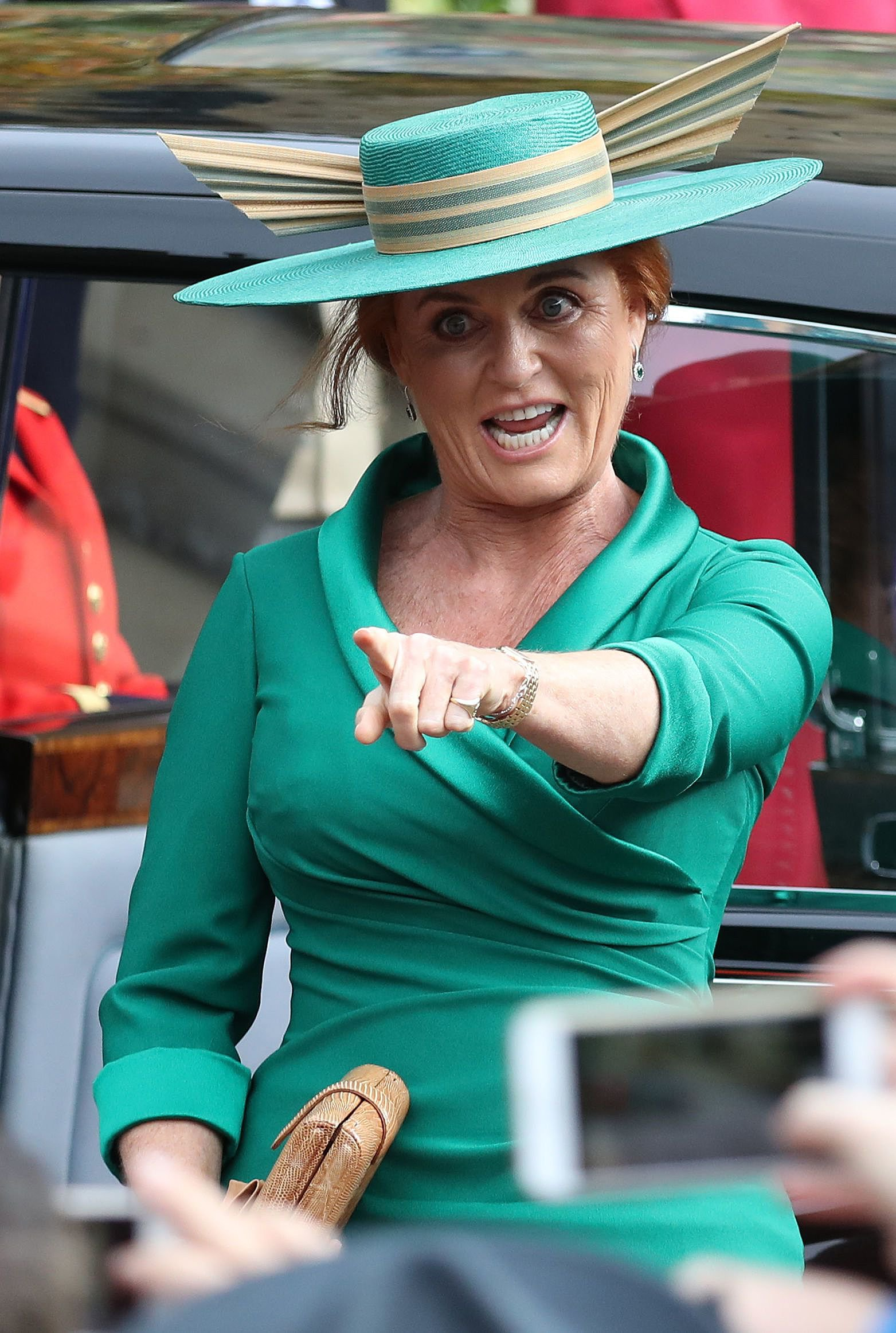 TOPSHOT - Mother of the bride, Sarah, Duchess of York arrives to attend the wedding of Britain's Princess Eugenie of York to Jack Brooksbank at St George's Chapel, Windsor Castle, in Windsor, on October 12, 2018. (Photo by Steve Parsons / POOL / AFP)STEVE PARSONS/AFP/Getty Images