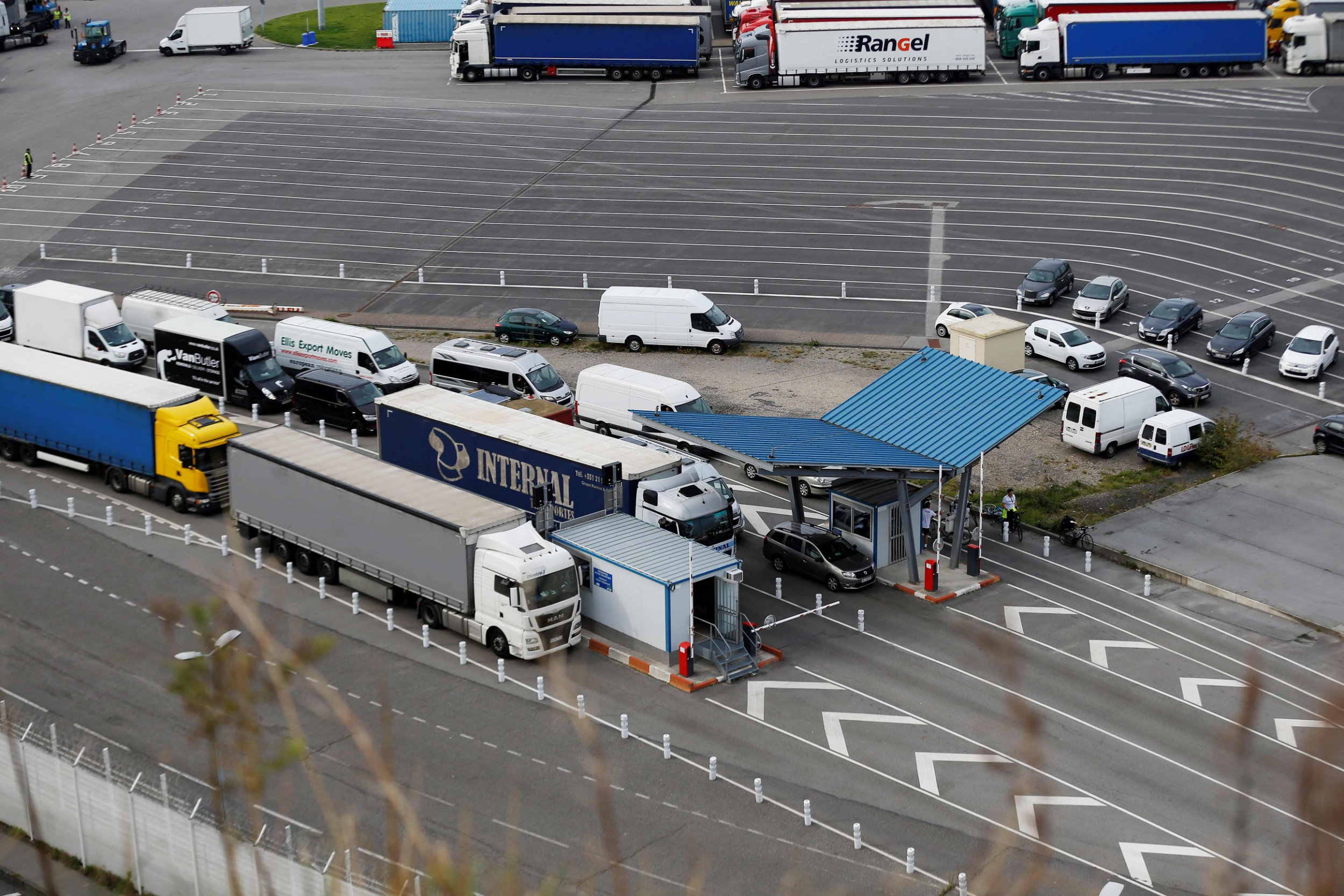 "Cars and trucks exit the DFDS Seaways Newhaven-Dieppe ferry ""Cote d'Albatre"" on October 11, 2018 in Dieppe's harbour, northwestern France. - Twice a day, three times in the summer, the ferry from Dieppe unloads up to 140 cars, 40 trucks and 600 passengers into the small fishing port of Newhaven; a historic link between England and France that is a way of life for some residents of the small English fishing port. Some residents are concerned that potential customs controls that might be introduced after Britain leaves the European Union could slow down traffic and hit small seaside towns like Newhaven and Dieppe disproportionately hard. (Photo by CHARLY TRIBALLEAU / AFP)CHARLY TRIBALLEAU/AFP/Getty Images"