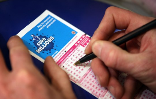 LONDON - FEBRUARY 07: A punter fills out a National Lottery ticket on February 7, 2008 in London. A record breaking jackpot of ?95 million is up for grabs in tomorrow's draw. (Photo by Peter Macdiarmid/Getty Images)