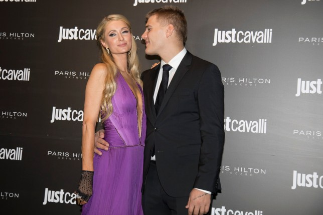 """Paris Hilton attends the """"ProD.n.a. skincare"""" launch party at the """"Just Cavalli"""" club in Milan, Italy wearing a new creation of designer Roberto Cavalli. Pictured: Paris Hilton,Chris Zylka Ref: SPL5035038 201018 NON-EXCLUSIVE Picture by: PMPhoto / SplashNews.com Splash News and Pictures Los Angeles: 310-821-2666 New York: 212-619-2666 London: 0207 644 7656 Milan: +39 02 4399 8577 Sydney: +61 02 9240 7700 photodesk@splashnews.com World Rights,"""