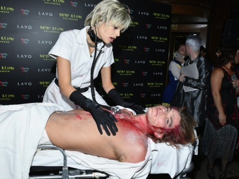 Model Jordan Barrett gets gruesome as he's wheeled into Heidi Klum's Halloween party on stretcher
