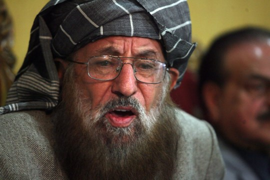 Maulana Sami ul-Haq, chairman of Defense of Pakistan Council (DPC), a coalition of around 40 religious and political parties, gives a news conference in Islamabad on November 4, 2013. The DPC announced it would hold countrywide protests on November 8, against the US drone strike that killed Taliban leader Hakimullah Mehsud on October 31. AFP PHOTO / SAJJAD QAYYUM (Photo credit should read SAJJAD QAYYUM/AFP/Getty Images)