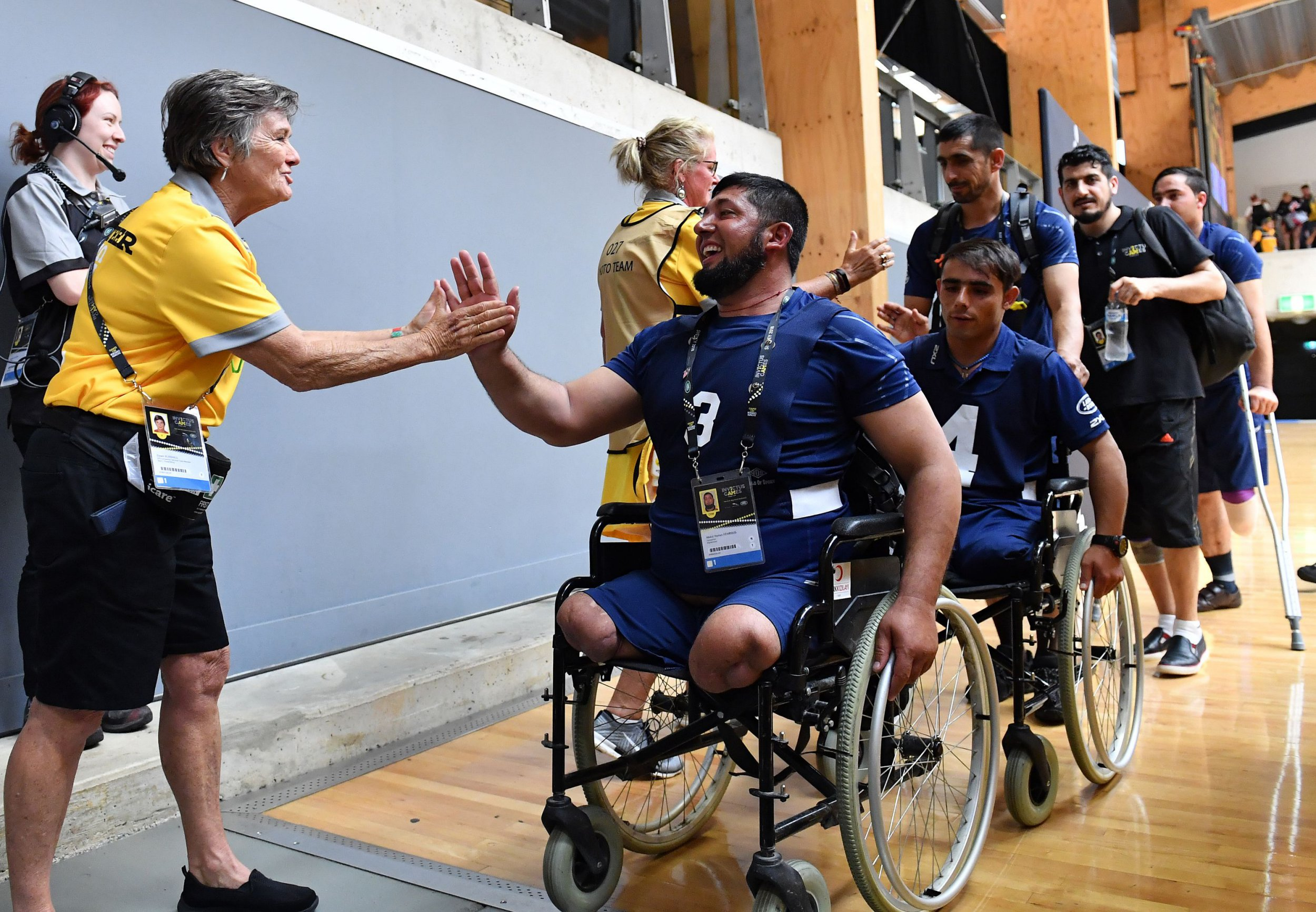Afghanistan players leaves after a defeat against Jordan in their sitting volleyball match of the Invictus Games in Sydney on October 22, 2018. (Photo by SAEED KHAN / AFP) / IMAGE RESTRICTED TO EDITORIAL USE - STRICTLY NO COMMERCIAL USE (Photo credit should read SAEED KHAN/AFP/Getty Images)