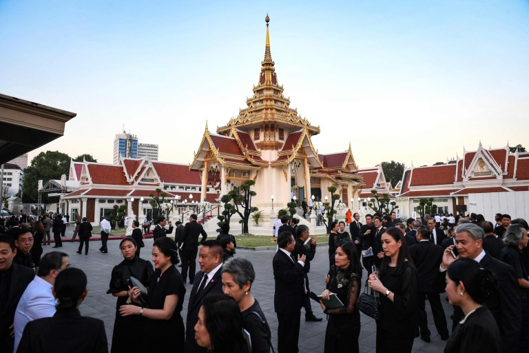 Mourners from Thailand's elite arrives at the Wat Thepsirin Buddhist temple in Bangkok for the funeral ceremony of Leicester City's Thai owner and duty-free mogul Vichai Srivaddhanaprabha on November 3, 2018. - Vichai, 60, and four other people died in a horrific helicopter accident moments after they departed the Leicester City's pitch a week ago, bringing an abrupt end to the fairytale life of Thailand's fifth-richest man. (Photo by Lillian SUWANRUMPHA / AFP)LILLIAN SUWANRUMPHA/AFP/Getty Images