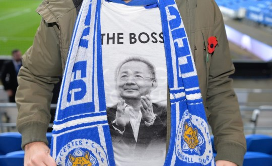 CARDIFF, WALES - NOVEMBER 03: Leicester City fans with special tribute t-shirts in honour of the Clubs late chairman Vichai Srivaddhanaprabha ahead of the Premier League match between Cardiff City and Leicester City at Cardiff City Stadium on November 3, 2018 in Cardiff, United Kingdom. (Photo by Plumb Images/Leicester City via Getty Images )