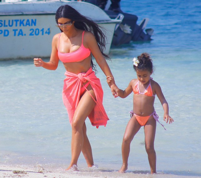 EXCLUSIVE: * UK Print Min Set Fee 500 GBP - Double Fees Page 1 * **Premium Exclusive** Kim and Kourtney Kardashian have fun with their children on the beach and on a huge boat in Bali. Scott Disick was also there playing around in the ocean with his kids. Pictured: Kim Kardashian,North West Ref: SPL5037697 301018 EXCLUSIVE Picture by: SplashNews.com * UK Print Min Set Fee 500 GBP - Double Fees Page 1 * Splash News and Pictures Los Angeles: 310-821-2666 New York: 212-619-2666 London: 0207 644 7656 Milan: 02 4399 8577 photodesk@splashnews.com World Rights