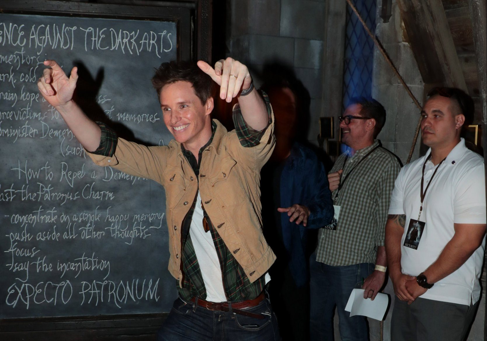 Eddie Redmayne can't stop smiling as he meets fans at Fantastic Beasts event