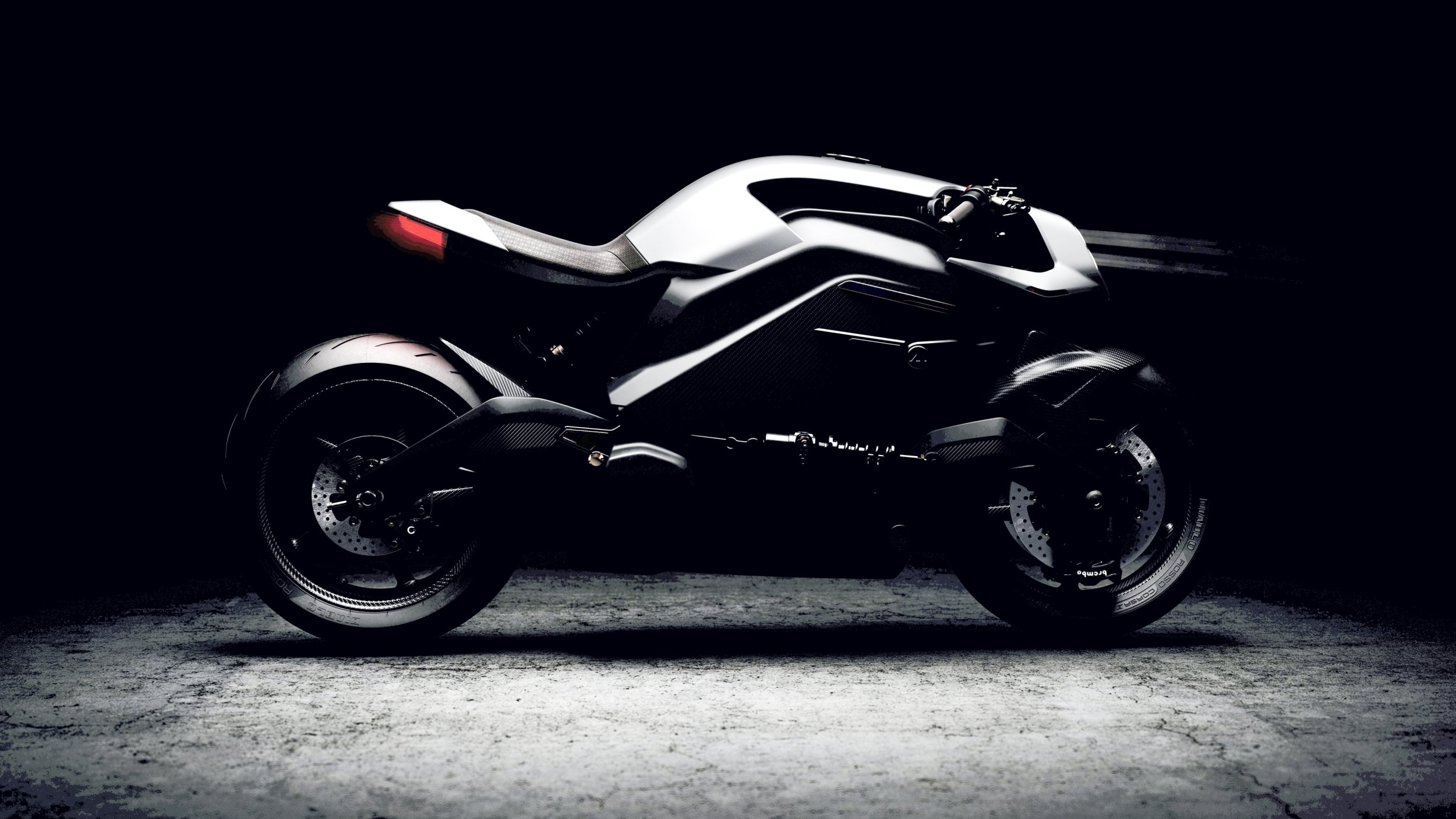 ***EMBARGO UNTIL 00:01 GMT, TUE 6TH NOV*** An electric motorcycle that comes with an Iron Man-like helmet and biker jacket that digitally connects the rider with the road has been tipped as one of the most advanced bikes ever made. See SWNS story SWBRbike; Built by a team of British engineers who have been likened to The Avengers, the futuristic design was launched at Milan???s EICMA Motorcycle show today (Tuesday 6th) and features a Human Machine Interface (HMI) that has been taken to another level. The Arc Vector utilises exotic materials, thoroughbred componentry and cutting-edge architecture with a Heads-Up Display (HUD) helmet and intelligent biker jacket. Priced at ??90,000, it???s aimed at rakish, trailblazing and eco-conscious millionaires. It???s the first model to be produced by Arc, a team of top engineering specialists based in Coventry, the UK???s high-tech automotive heartland, who have been likened to Marvel's superhero team by the company???s founder. The Zenith helmet has been designed in collaboration with British company Hedon, with speedo, sat-nav and ancillary graphics projected onto the rider???s visor so they can keep their eyes affixed to the road, Iron Man-style. A live rear-view camera is encased in the calfskin-trimmed helmet, giving the user the ability to see what???s behind them. The bespoke jacket, called Origin, has HMI applied to the armoured ride-wear as well as audio-type haptic amplifiers, which work like a smart phone???s vibration notifications. These may vibrate to alert of a potential hazard, provide dynamic performance-based feedback, or stir the senses when on a stimulating ride. Arc???s founder Mark Truman, who is ex Jaguar Land Rover, said: ???We felt that there was more one could get out of motorcycling which no one was tapping into.
