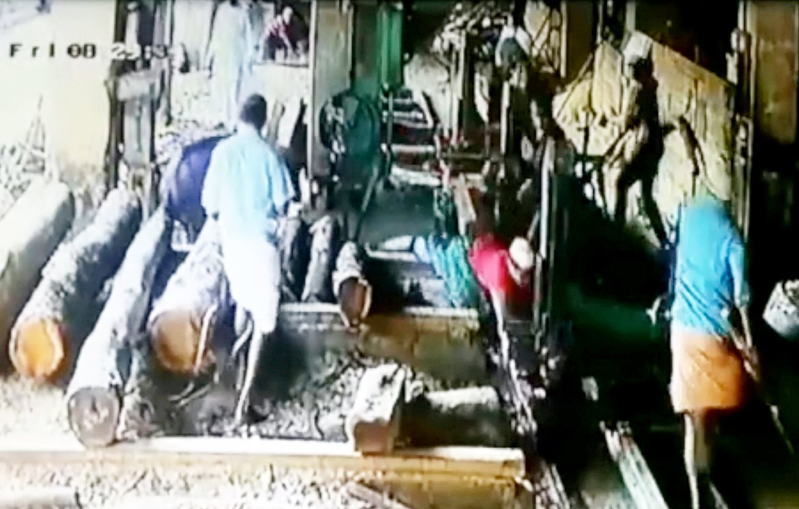 A man lost his hand after he ran away from a stampeding bull - into the blade of a saw mill. See SWNS story SWOCsaw. The victim, known only as Rauf, was buying some wood when his red-t-shirt attracted the bull which charged straight at him. Although Rauf, 22, managed to flee before the bull inflicted any injury he ran straight into the working saw-mill and his hand was severed by the blade. His palm was kept in a bag of ice and plastic surgeons have now successfully replaced the limb through a rare operation and it is hoped he will regain full use of it. The freak accident happened in Manipuram in India on October 5.