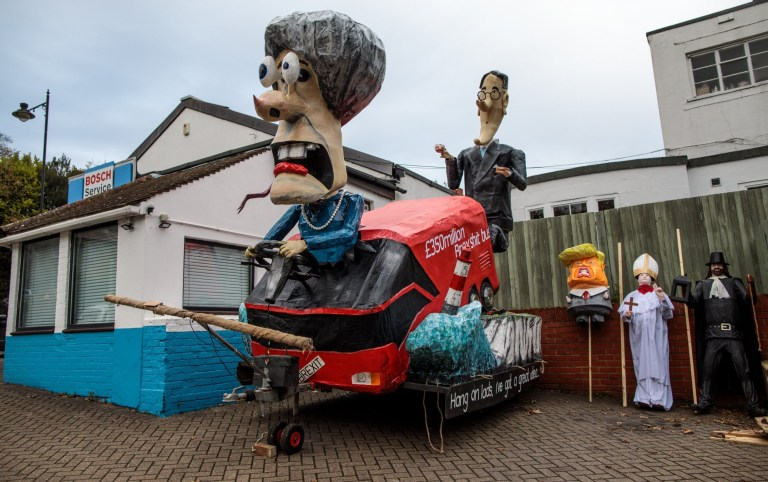 LEWES, ENGLAND - NOVEMBER 05: Effigies including one featuring British Prime Minister Theresa May and Jacob Rees-Mogg sit near the parade route ahead of Bonfire Night celebrations on November 05, 2018 in Lewes, England. The night's events commemorate Guy Fawkes, who planned the failed 1605 Gunpowder Plot - an attempt to blow up The Houses of Parliament by a group of English Catholics. Bonfire night celebrations often end with the burning of an effigy of a popular hate figure or a 'guy' representing Guy Fawkes. (Photo by Jack Taylor/Getty Images)